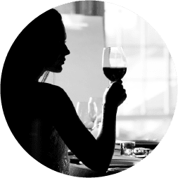 Woman enjoying wine in a Vancouver Waterfront tasting room