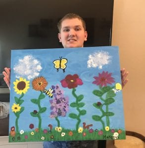 Student with his art at Starry Starry Night